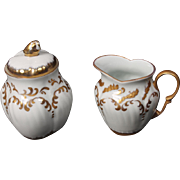 Beautiful Hand Painted Limoges White with Heavy Gold Decorated Creamer and Lidded Sugar from the Lakides Studios and signed by the artist Barbara Zeeman.