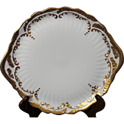 Beautiful Hand Painted Limoges White with Heavy Gold Decorated Cake Plate with Handles believed to be from the Lakides Studios and by the artist Barbara Zeeman but is not signed.