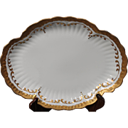 Beautiful Hand Painted Limoges White with Heavy Gold Decorated Round Serving Platter from the Lakides Studios and signed by the artist Barbara Zeeman (BZ).