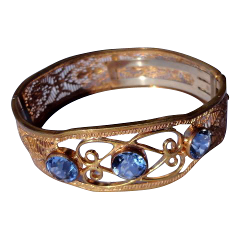 Art Deco Gold Tone Metal Ornate Filigree Bangle Bracelet With Blue Rhinestones