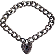 Sterling Silver Repousse Heart Lock Charm Bracelet