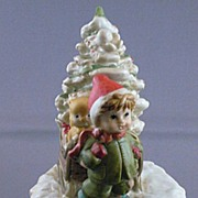 Ceramic Christmas Music Box of Young Child with Christmas Tree and Sled