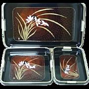 Vintage three piece nested laquerware tray set
