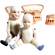 Lovely Pair of German Bisque Porcelain Dolls Woven Straw Furniture
