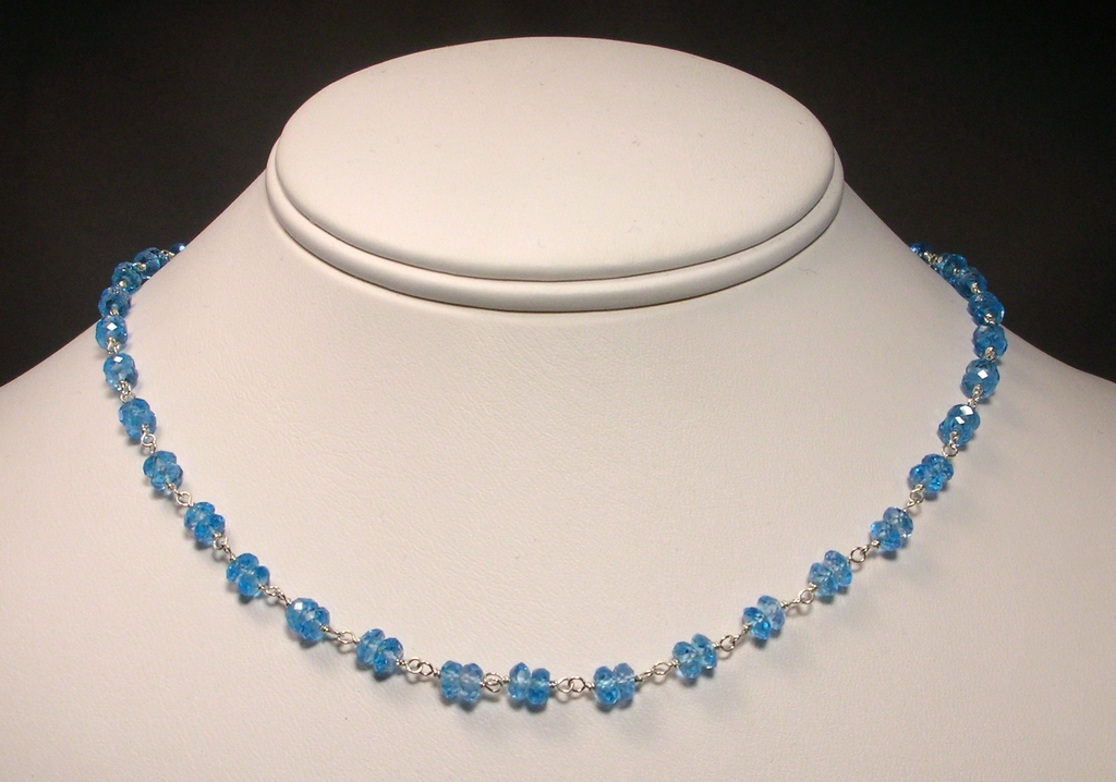 Sterling Silver Blue Topaz Necklace with Stylized Clasp