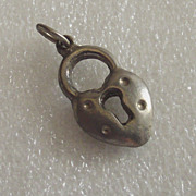 Small Silver tone Lock Charm