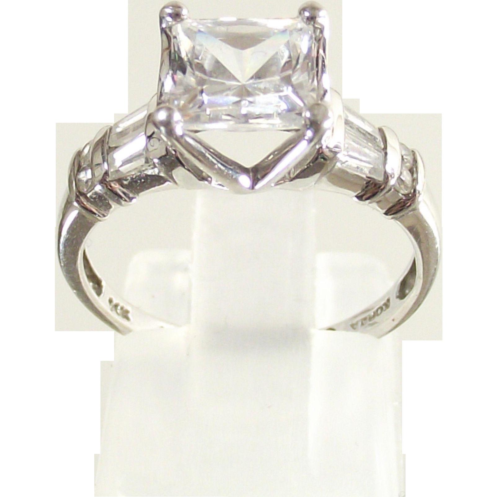 Vintage 14 Kt. White Gold  Ring sz six   Princess Cut  Rounds  and  Baguette  CZs.