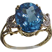 Vintage  Swiss Blue Topaz with a  Checkerboard Cut Three Caret Stone in TenKt Yellow Gold Ring  Size Six and one half