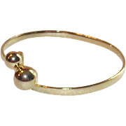 Gold Tone By Pass Bangle Bracelet