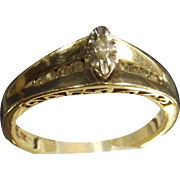 Ten Karet Yellow and White Gold Diamond Ring