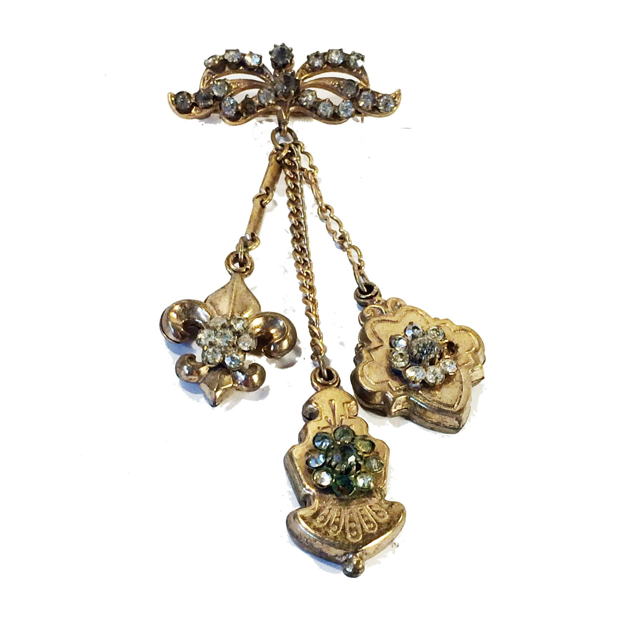 Older Gold Tone Metal Bow Shaped Bar Brooch with Three Dangling Detailed Fobs