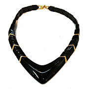 NAPIER Black Resin and Gold Tone Spacer Beads Segmented Space Age Necklace