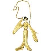 Large Articulated 6 1/4 Inch Geisha Pendant Necklace with Enamel and Leaf Textured Gold Tone Metal