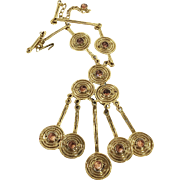 GOLDETTE Swirling Modernist Gold Tone Pendant Necklace with Amber Color Colette Set Stones
