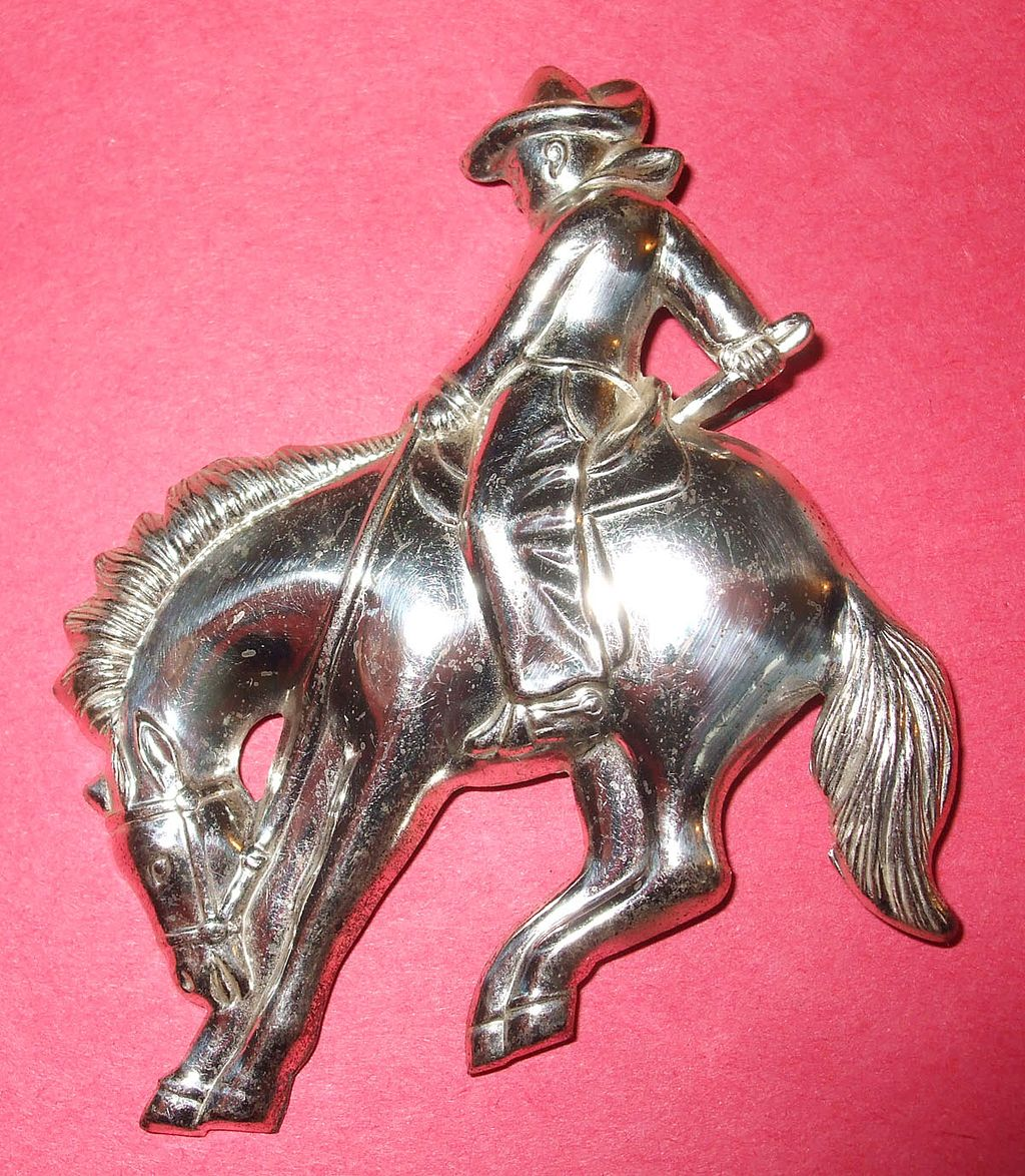 Americana Bronco Riding Cowboy on a Horse Stamped Figural Brooch
