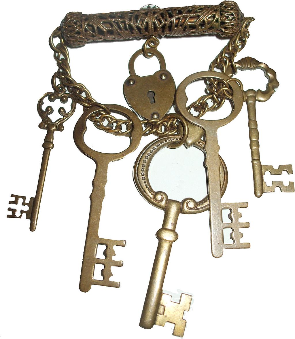 Older Brass Filigree Dangling Lock and Multi Key Brooch