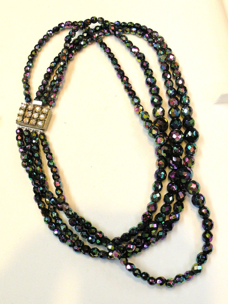 Four Strand Oil Slick Iridescent Graduated Bead Necklace with Rhinestone Clasp