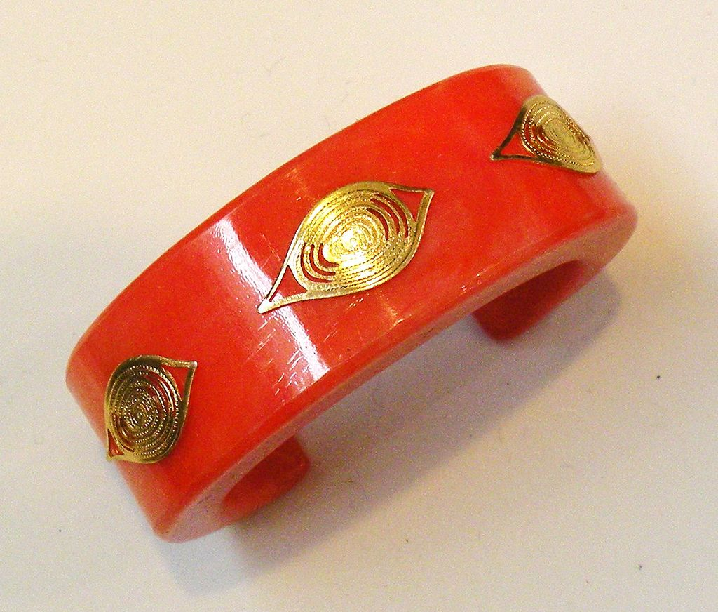 Orange Resin Cuff Bracelet with Gold Tone Metal Filigree Designs