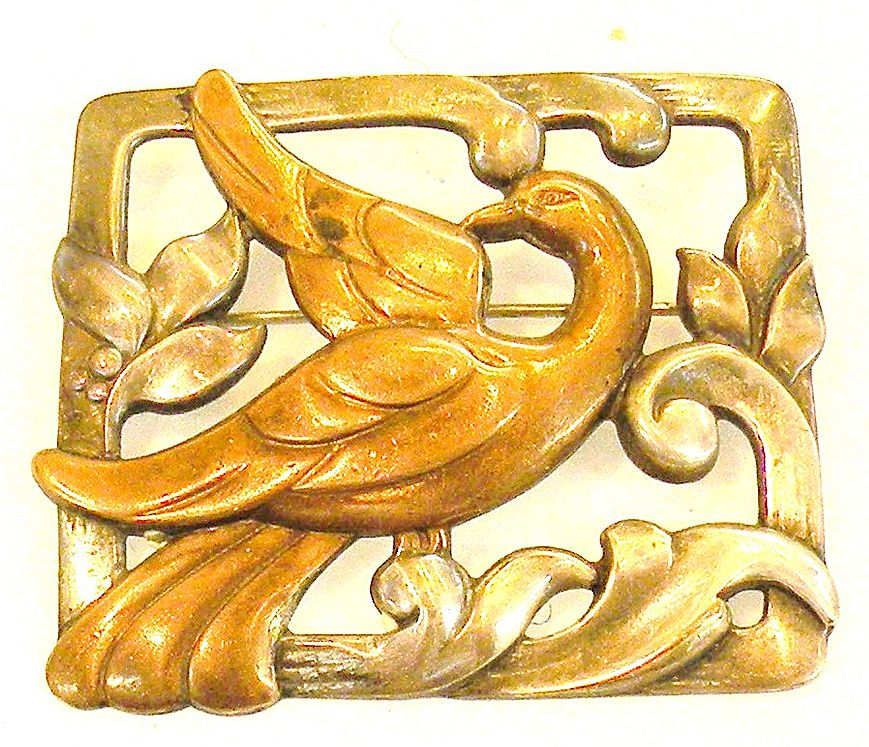 Mixed Metal Framed Bird on a Wave and Leaf Brooch