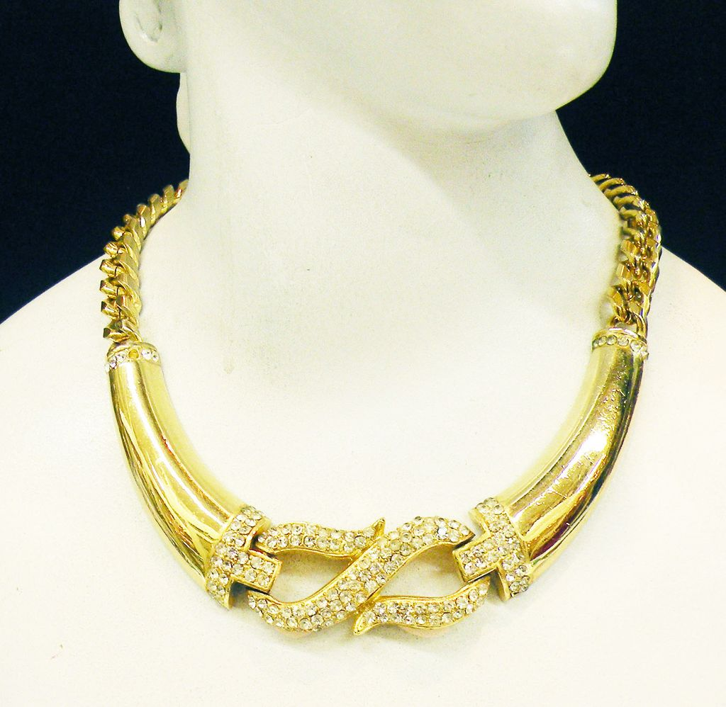 "1980s Bold ""S"" Cross Over Design Gold Tone Metal Necklace with Rhinestone Accents"