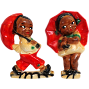 Black Americana Larger Pair Wall Plaques.  1940's.  Boy & Girl in Rain.