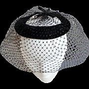 Black Velvet and Net Cocktail Hat.  Vintage Chic.  Mint Condition.