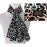 100% Silk Scarf.  Black with White Circles.  Rectangular. Eye-catching Quality. As New Condition.