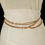 "1960's Chain Belt.  Gold Toned Metal.  Adjustable. 59"" Long."