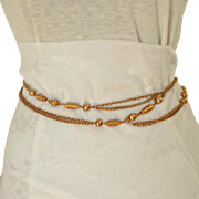 "1960's Chain Belt.  Gold Toned Metal.  Adjustable. 59"" Long."