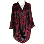 Pashmina.  Wine on Wine Color. Patterned all over with the letter G and GUCCI Written Across Both Ends.  Mint Condition.