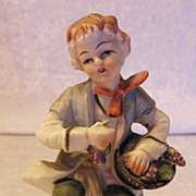 A Bisque Figurine of a Seated Youth C. 1890