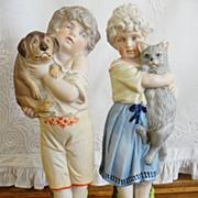 German Bisque Figurines Boy & Girl with Cat & Dog