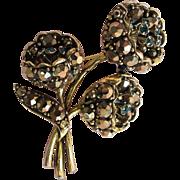 Unusual Weiss Pin - Bronze & Emerald Color Rhinestones