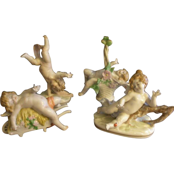 Set of 4 Scheibe-Alsbach Porcelain Frolicing Nude Cherub Figurines