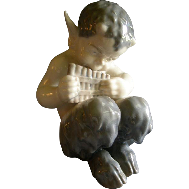 "Royal Copenhagen Figurine ""Faun With A Pan Flute"" #1736, Sculptured by Christian Thomsen"