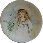 T & V Limoges Hand Painted Portrait Plate of Darling Young Girl in her Easter Outfit