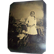 Tintype Photo of Girl With China Head Doll In Stroller