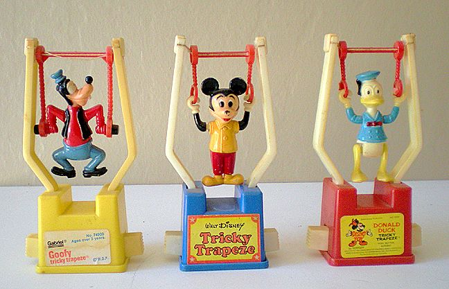 Toys Easter Magazine : Different vintage disney character trapeze toys