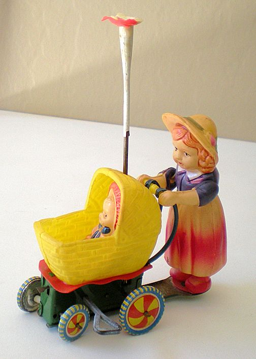 Old Celluloid Wind Up Toy Japan  Stroller With Baby