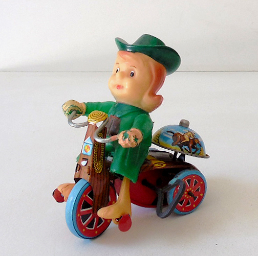 Vintage MARX Wind Up Cowgirl On Tin Litho Tricycle