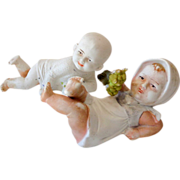 (2) Marked German Bisque Children Figurines Piano Baby