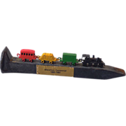 Old Railroad Spike With Attached Toy Metal Train
