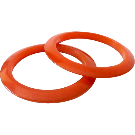 Pair of Vintage 1930s Orange Bakelite Flying Saucer Bracelets