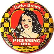 1930s Lucky Brown Hair Dressing Oil Tin Black Americana
