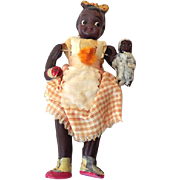Scarce 1920s Celluloid doll Black Girl Holding a Doll