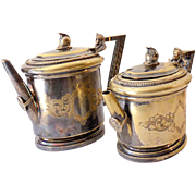 Matched Pair Manhattan Silver Plated Tea and Coffee Server Figural Handles