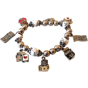 Silvertone Stretch Charm Bracelet With Gambler's Beads