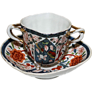 Bouillon 3 Footed, 2 Handled Cup and Saucer