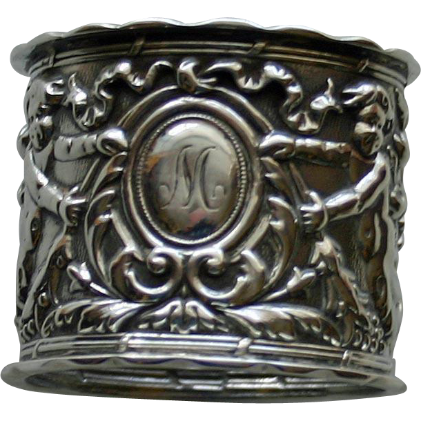Hallmarked 1905 English Sterling Repousse Napkin Ring, Cherubs with Leafy Tails  by Thomas Hayes, Birmingham