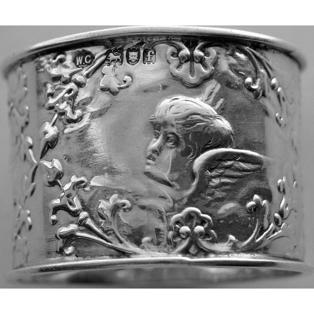English Hallmarked William Comyns Sterling Napkin Ring with Cherubs (1901)